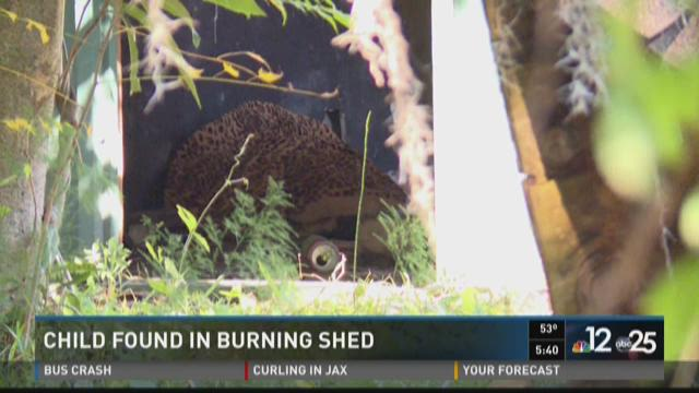 Child rescued from burning shed