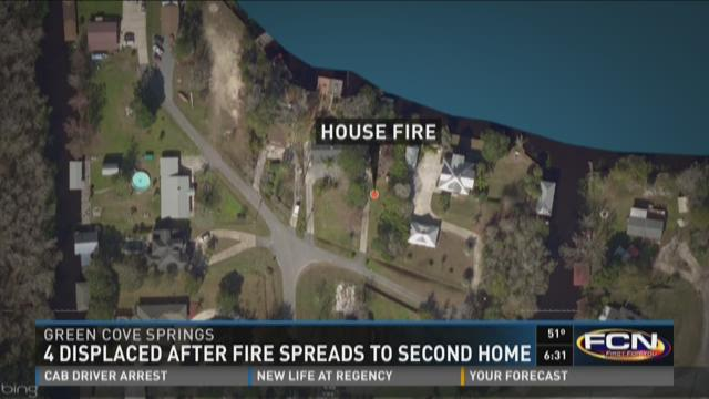 4 displaced after fire spreads to second home