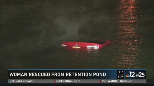 Woman rescued from retention pond