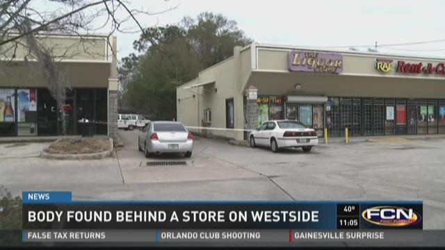 Police: Body found behind Westside strip mall
