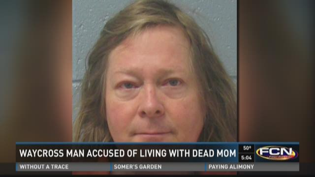 Waycross man accused of living with dead mom