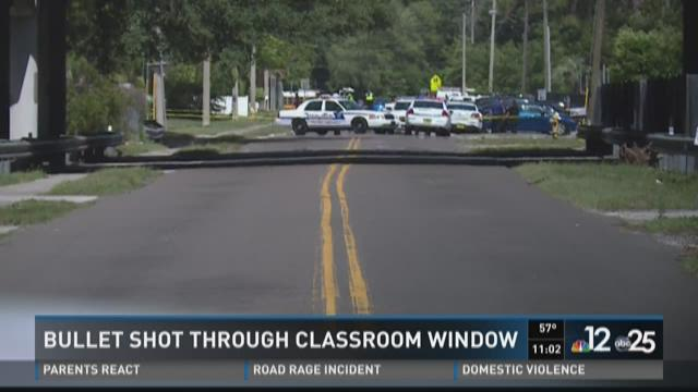 Bullet shot through classroom window