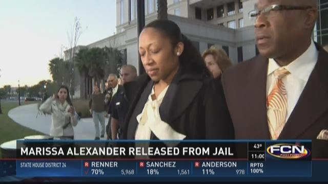 Marissa Alexander gives a statement to the media following