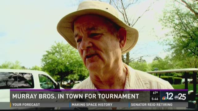 Bill Murray lifts reporter Lindsey Boetsch at his charity