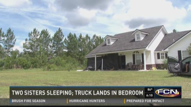 Two sisters sleeping; truck lands in bedroom