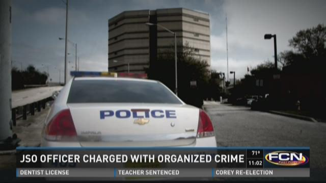 JSO officer charged with organized crime