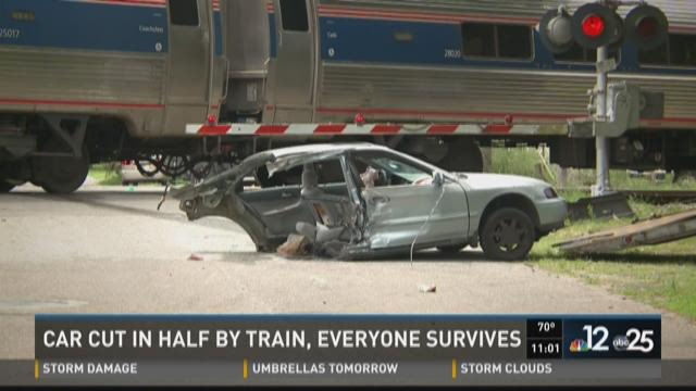Car cut in half by train, everyone survives