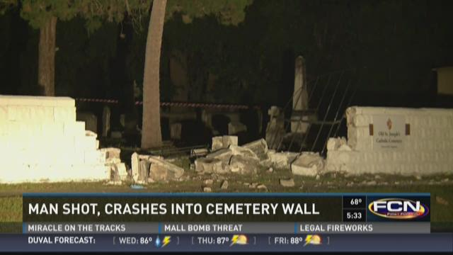 Man shot, crashed into cemetery wall