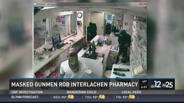 The suspects ransacking the pharmacy in Interlachen.