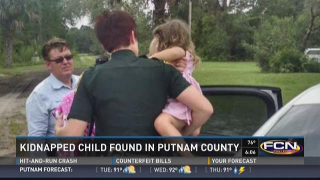 Lilly Baumann, 3, with Capt. Dominic Piscitello and