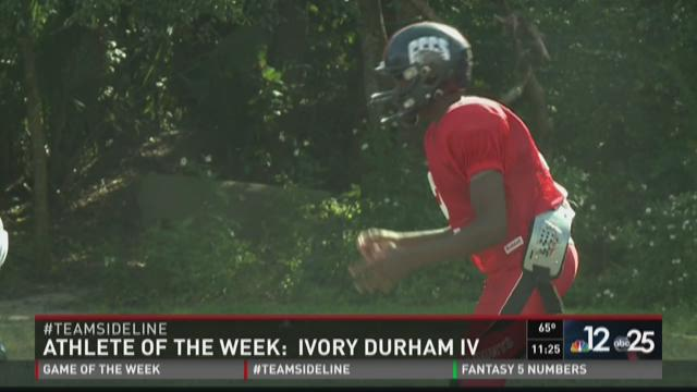 Ivory Durham IV chats with two of his coaches from