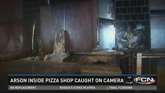 Arson inside pizza shop caught on camera